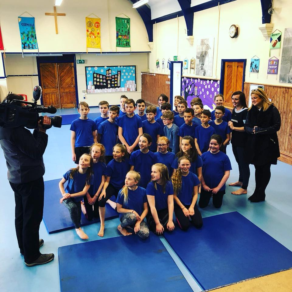 "YOGADOO is set to feature on the local BBC television, BBC Point's West this week (Friday 16th March). BBC Presenter, Imogen Sellers visited High Littleton Primary school where YOGADOO founder and teacher, Lucy Aston is running a weekly  yoga and relaxation session for year 5 and year 6 pupils who are preparing for their SATS exams.  YOGADOO has also recently tipped over the half century of schools in which we are working in some way with either teachers or pupils.   The report is due to be on BBC Points West on Friday 16th March at 6:30pm.  Presenter, Imogen Sellers interviewed YOGADOO's Lucy Aston, some of the High Littleton pupils, and the Primary schools' Deputy Head, Ian Gunning.  Lucy Aston founder of YOGADOO: ""The pupils are High Littleton have been learning really practical ways to relax their bodies and focus their minds, through yoga, breathing and relaxation techinques Of course, these will help the pupils to learn to calm their minds and focus in school but are also vital life tools which will hopefully stay with forever. High Littleton have invested in ten weeks of YOGADOO sessions for their pupils and the children are already responding incredibly positively."""