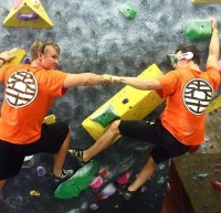 Team Kaioken Climbers shares a moment on the bouldering wall.