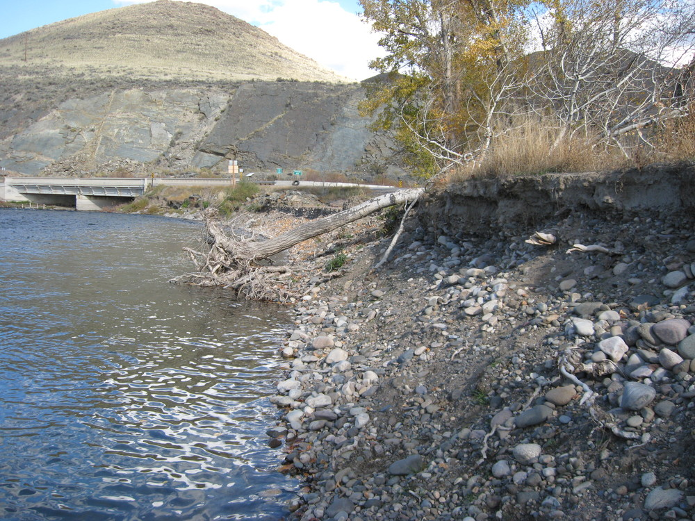Before - downstream - unstable eroding bank, destroying established river access and threatening highway bridge