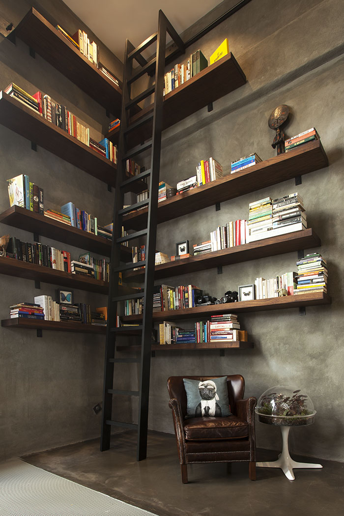 Interlocking walnut shelving system with 15-foot steel ladder.