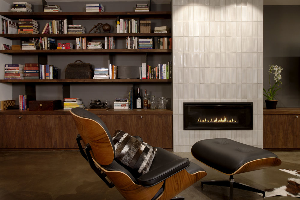 Reimagined downstairs lounge including tiled fireplace from  Heath ceramic tiles .