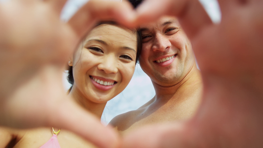 close-up-ethnic-couple-hands-heart-shape-social-media_4jnygpka__F0000.png