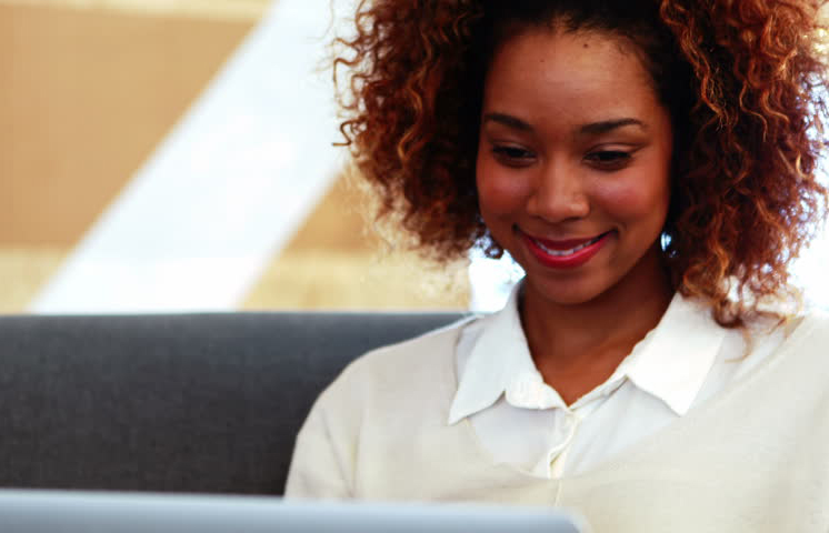 Black Lady at Laptop Smiling.jpg