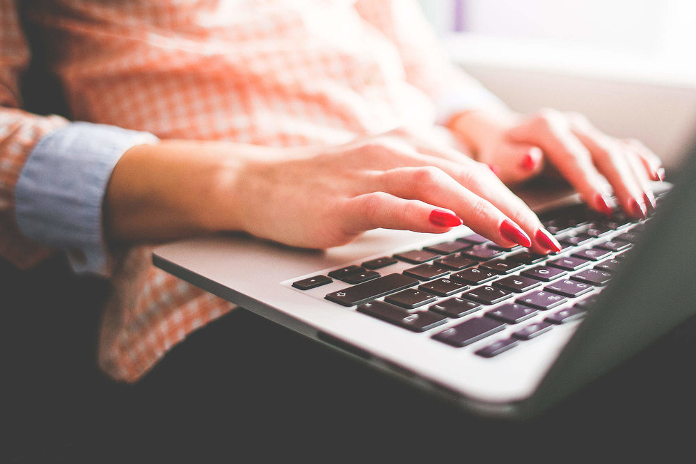 Woman typing an email.jpg