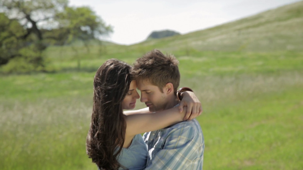 young-couple-hugging-and-talking-to-each-other-in-nature_suve46vmx_thumbnail-full01.png
