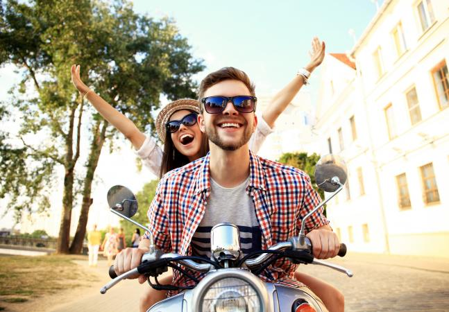207103-647x450-Happy-couple-on-scooter.jpg