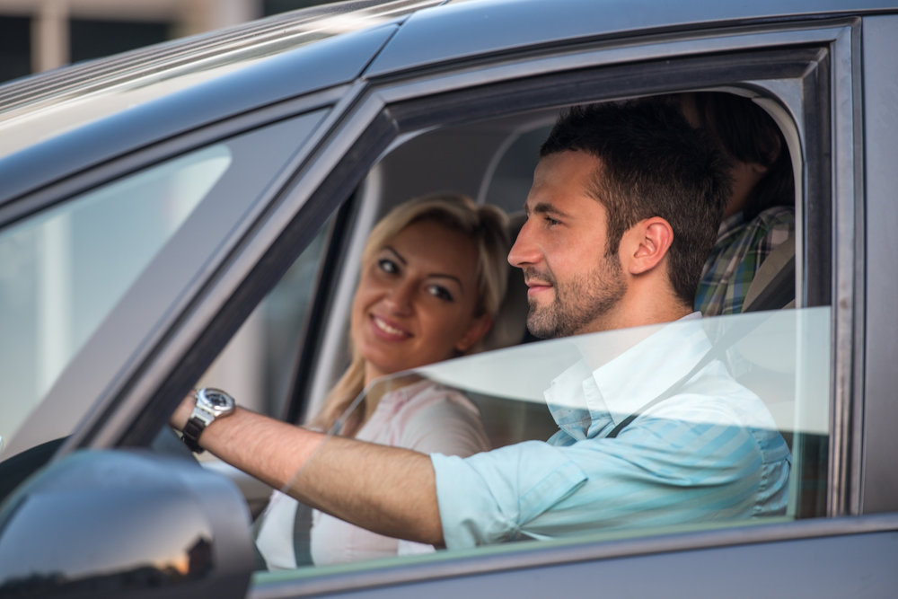 outside-view-of-happy-handsome-couple-driving-in-automobile_HYfm9VTHs.jpg