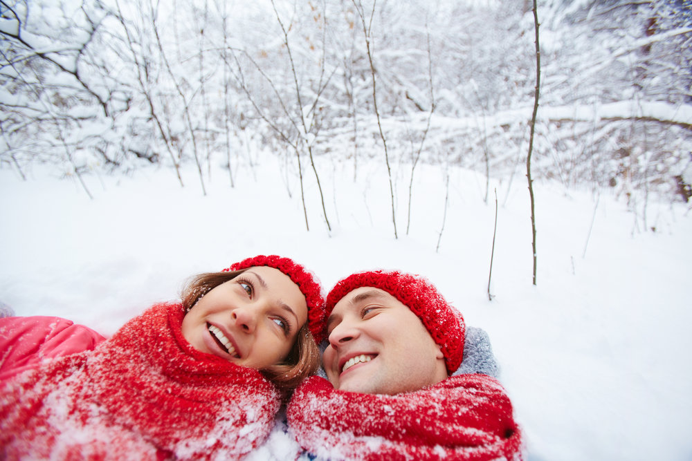 graphicstock-happy-man-and-woman-lying-in-snowdrift-in-winter-park_HrxY04tjlW.jpg