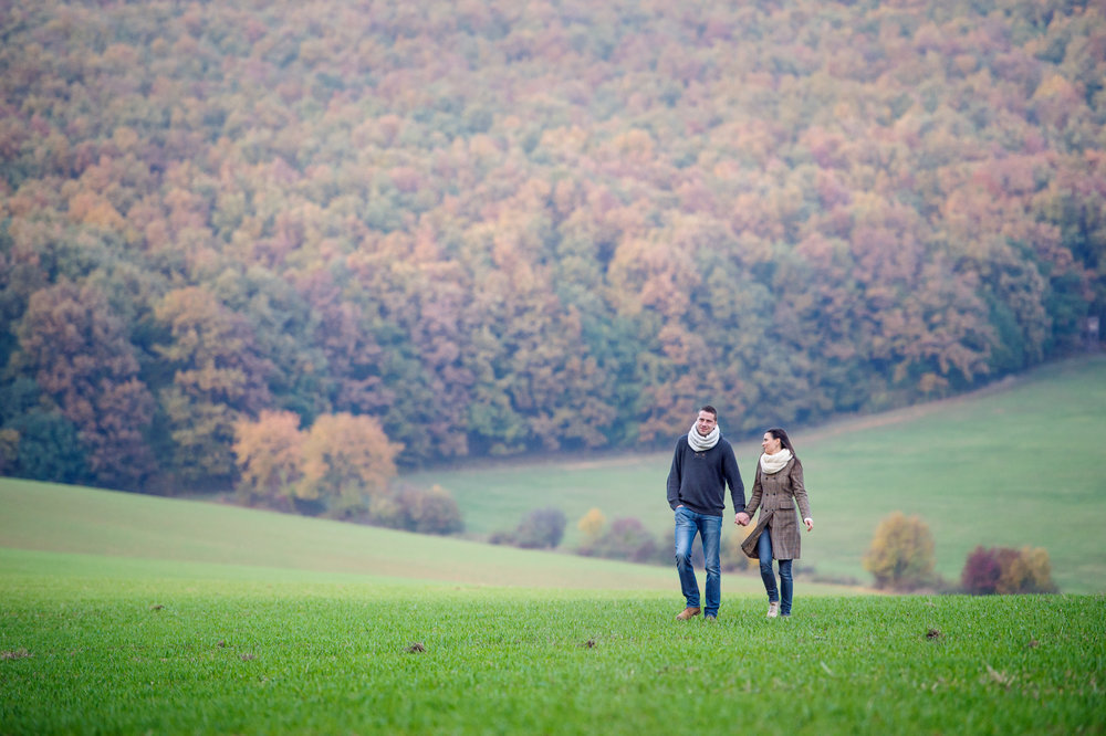 graphicstock-beautiful-young-couple-on-a-walk-holding-hands-colorful-autumn-nature_B_WgdzKSM-.jpg