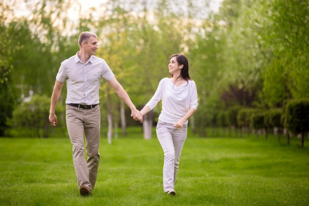 happy-couple-walking-in-park_1163-3225.jpg