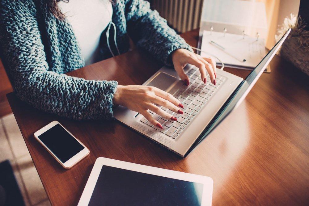 Woman at computer smaller.jpg