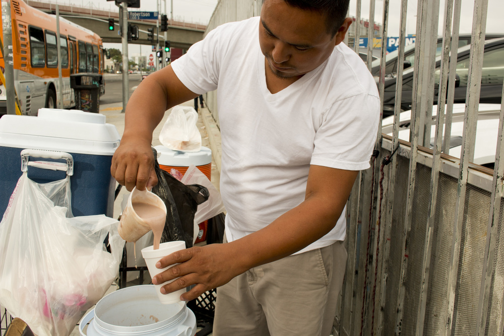 Marcos serving the traditional Mexican chocolate drink champurrado.