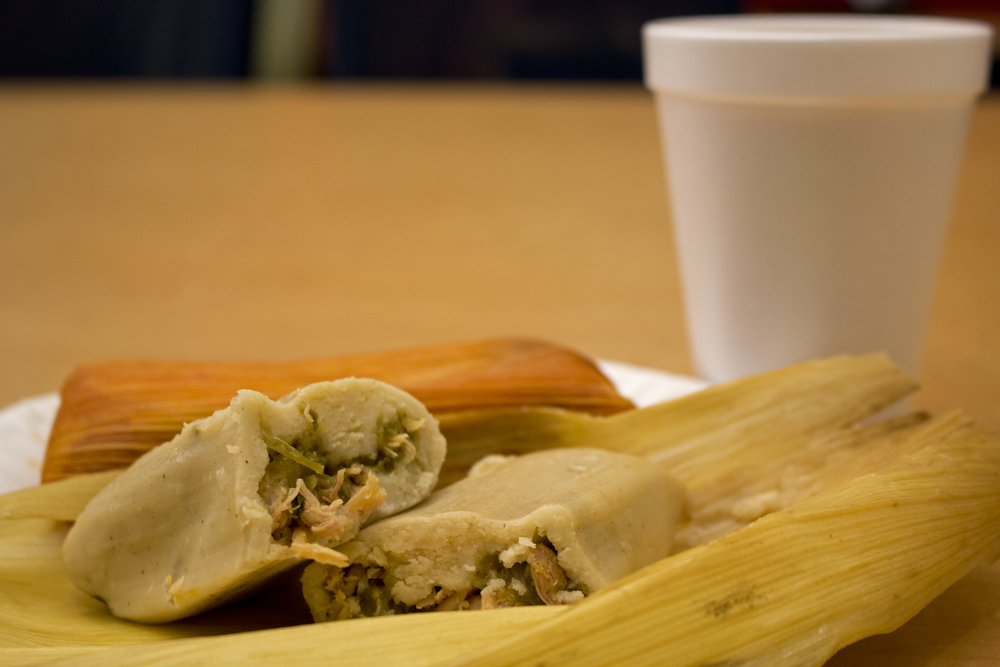 A filling and inexpensive $3 breakfast: a chile verde chicken tamal and a champurrado from one of L.A.'s many tamaleros.