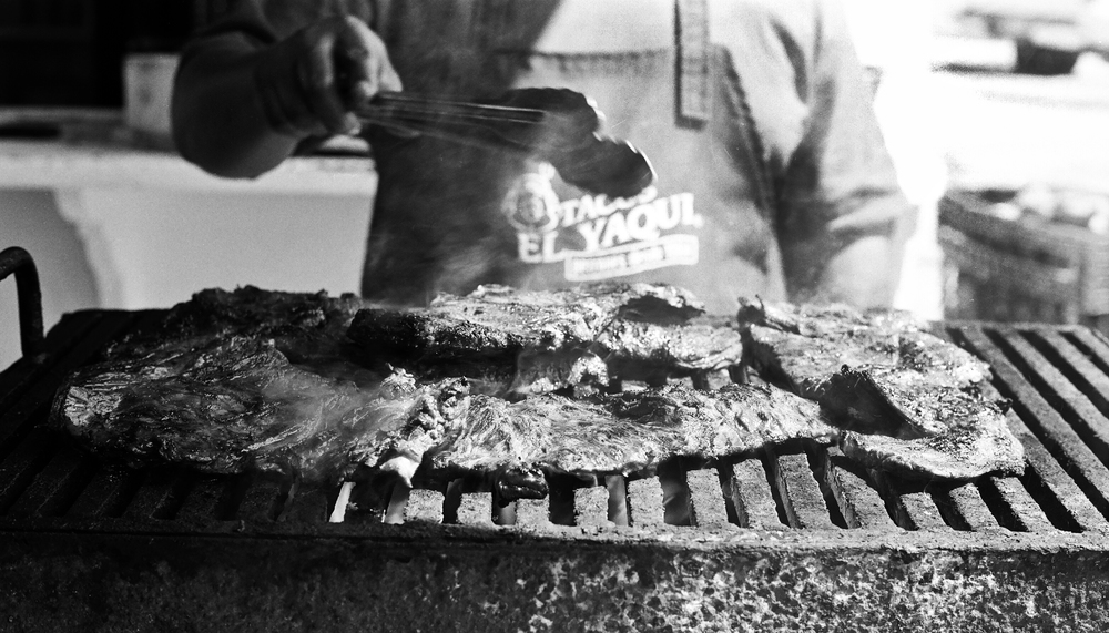 Carne asada grilling at Tacos El Yaqui. Rosarito, Baja California, Mexico. 35mm.