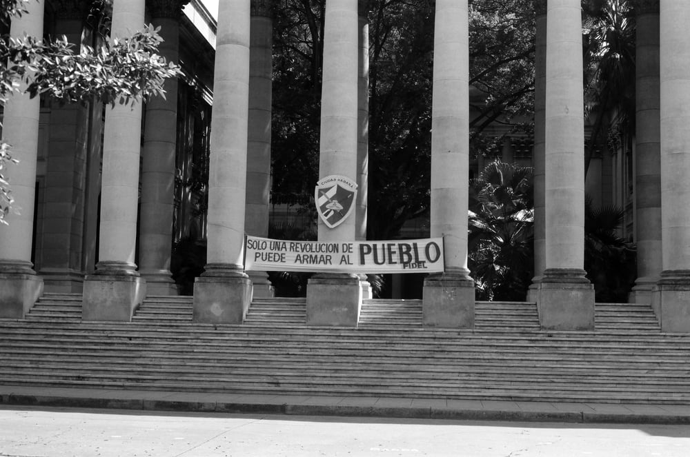 "Banner at the University of Habana, ""Only the revolution of a village can arm a village."""