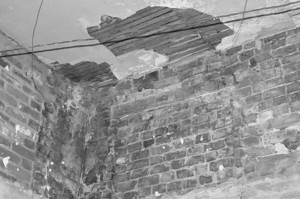 Deterioration of masonry construction.