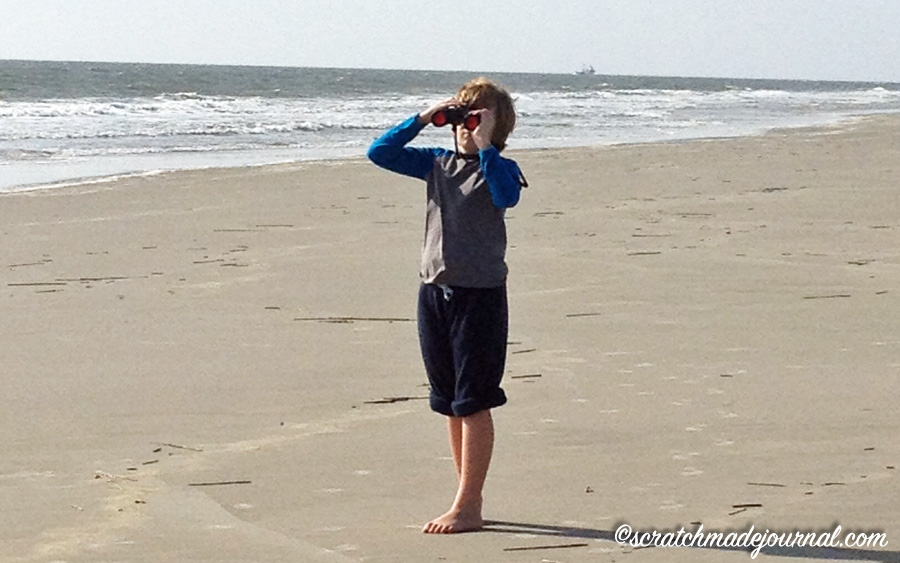 Our son exploring the distant shore with field binoculars.
