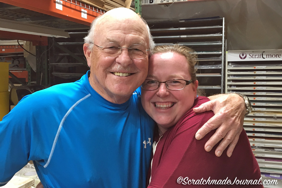 "It's a family business: Joe Miller, aka ""Cheap Joe,"" poses inside his massive warehouse with his employee and granddaughter Meghann."