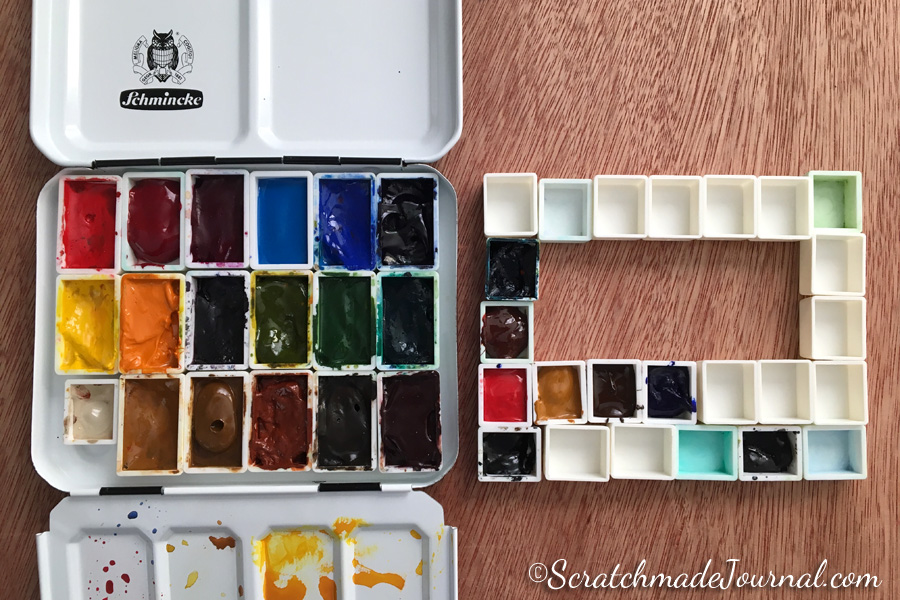 Schmincke square watercolor tin filled with extra pans - ScratchmadeJournal.com
