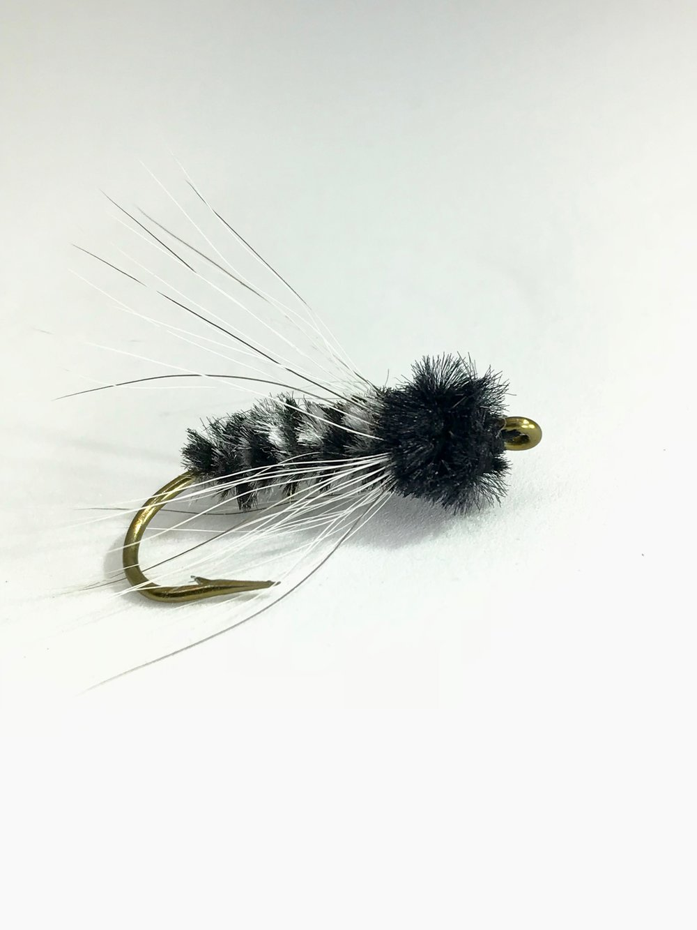 A variation of the James Wood Bucktail meant to imitate a baby crappie.
