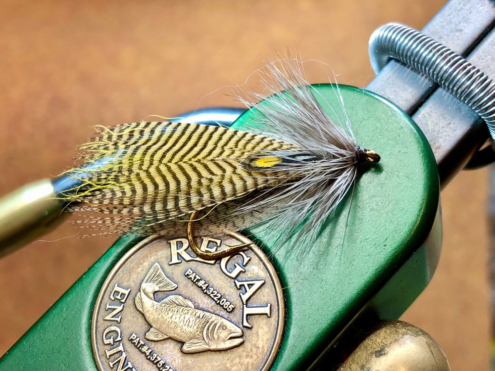 A Hornberg Streamer with a wood duck flank feathers and artificial jungle cock eyes.