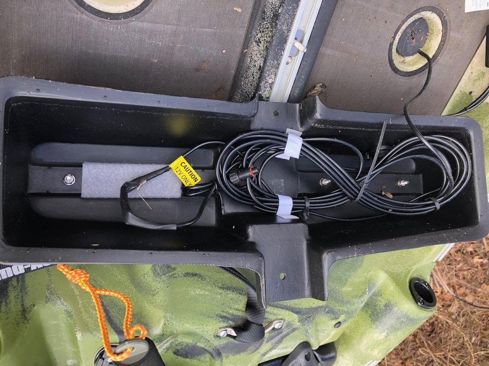 All of my fish finder's cables store neatly under the foot rest.  The small lithium battery (not in the photo) attaches to the strip of velcro.  Everything is neatly stored and the best part - no drilling!