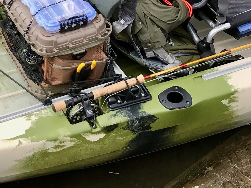 The fly rod holders on this kayak will work with any sized fly reel and will store a nine foot rod with it's tip protected.