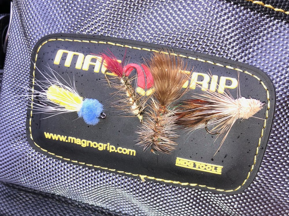 The magnetic pouch on the front of the bag makes a great spot for drying and storing flies.
