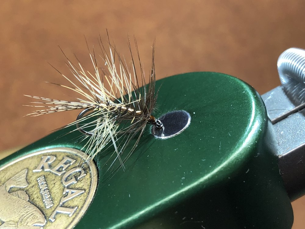 A lighter version of The Tick tied with a ginger hen feather.