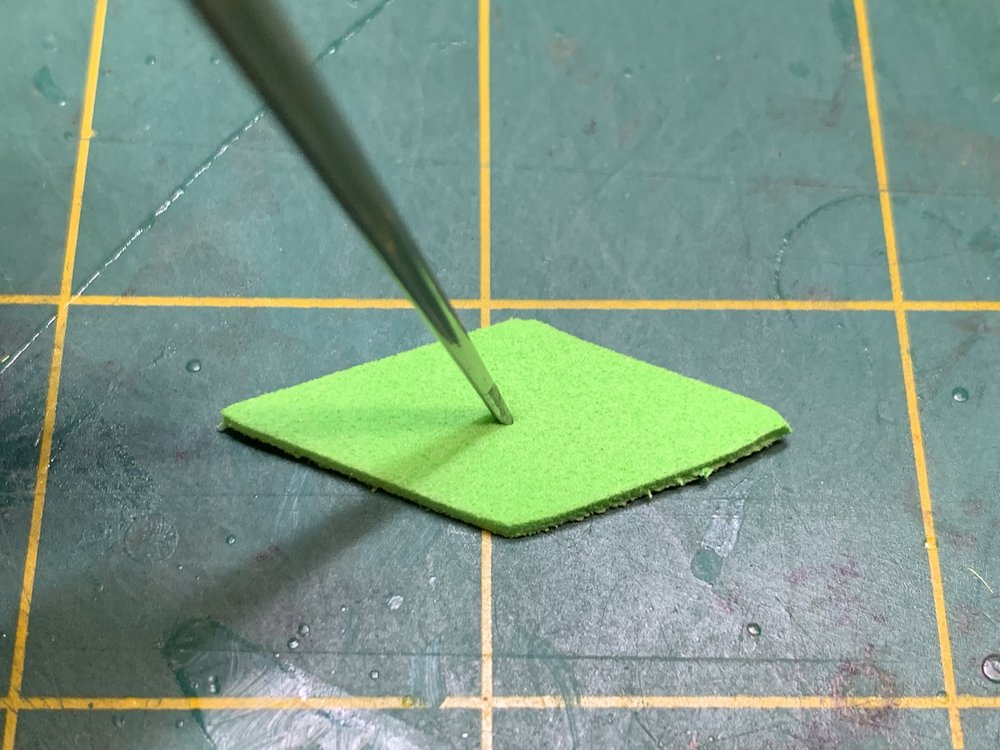 Step 7 - Prepare the Triangle Bug Body for mounting on the hook by taking a bodkin or a needle and poking a hole in the center.