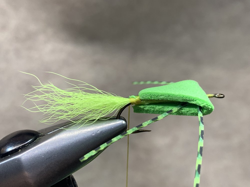 Step 13 - Secure the bottom edge of the foam with thread wraps. If gaps exists on the sides of the fly as pictured you can apply a drop of super glue with the tip of your bodkin into the opening and pinch it closed. This is for appearances only, it will not effect how the fly fishes.