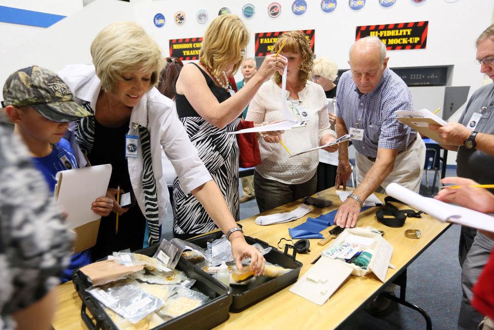 Participants Examine On-Board Materials