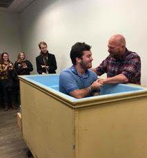 Asher getting baptized