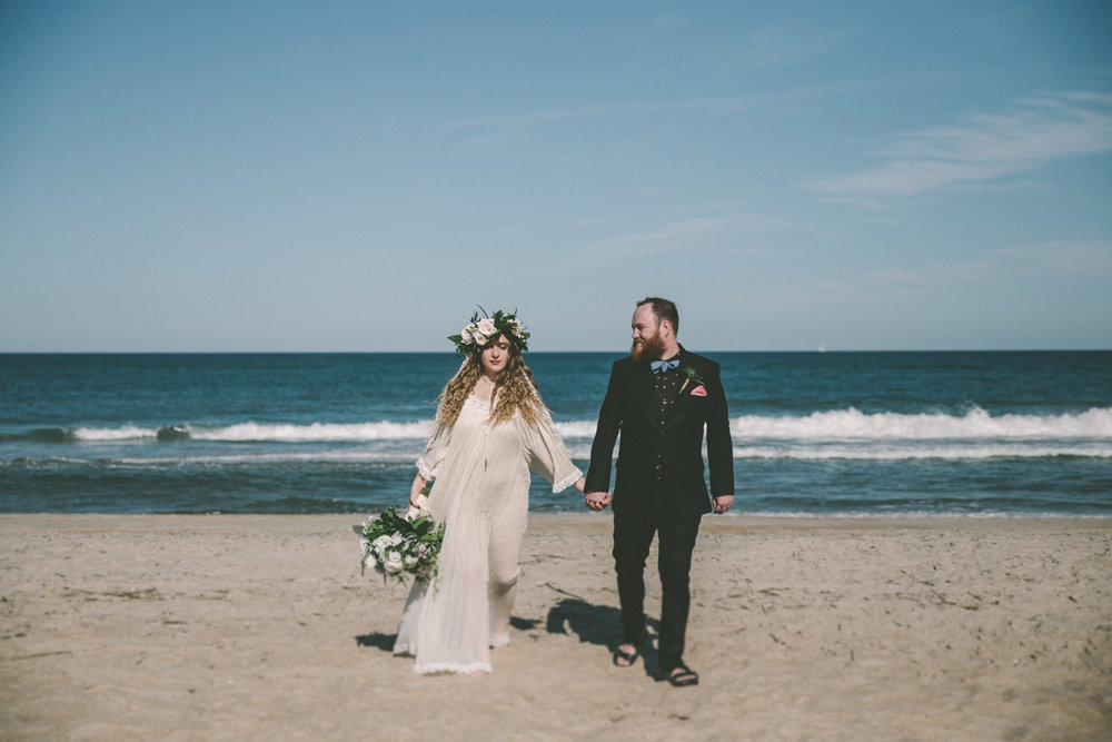 beach wedding bride and groom walking.jpg
