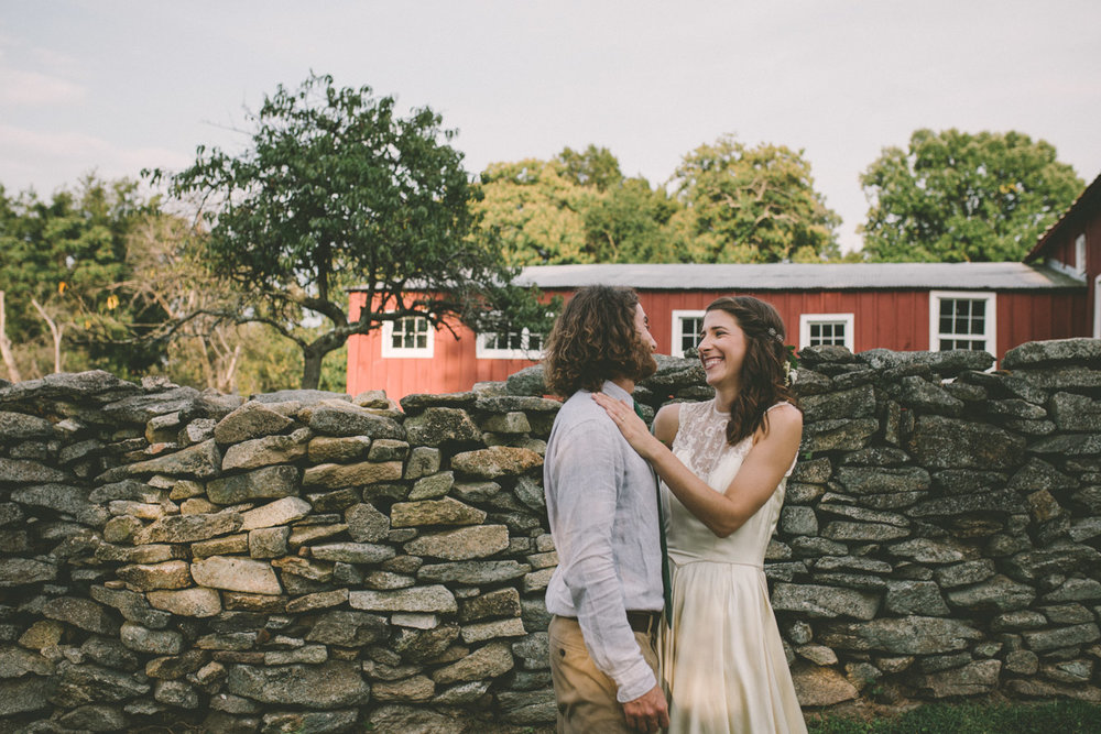 bride and groom laughing steppingstone museum red barn.jpg