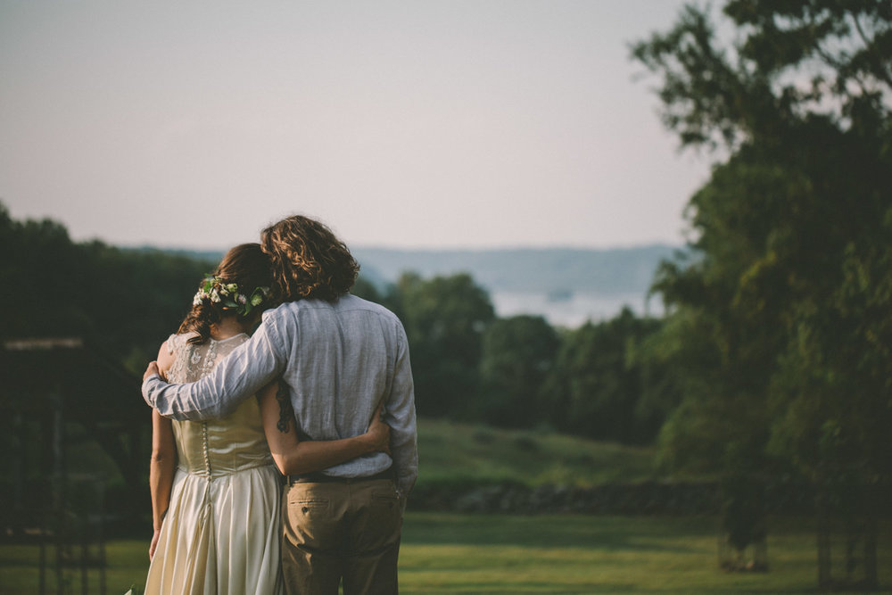 bride and groom steppingstone museum looking at river.jpg