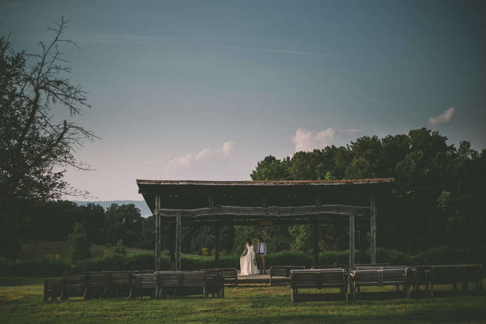 bride and groom steppingstone museum stage river.jpg