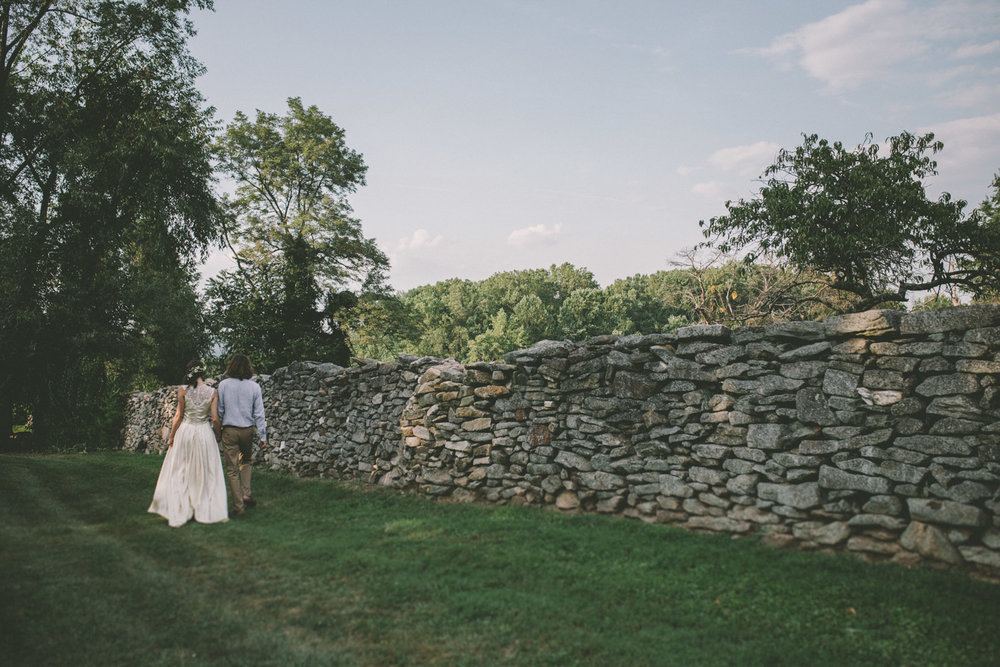 bride and groom steppingstone museum walking away.jpg
