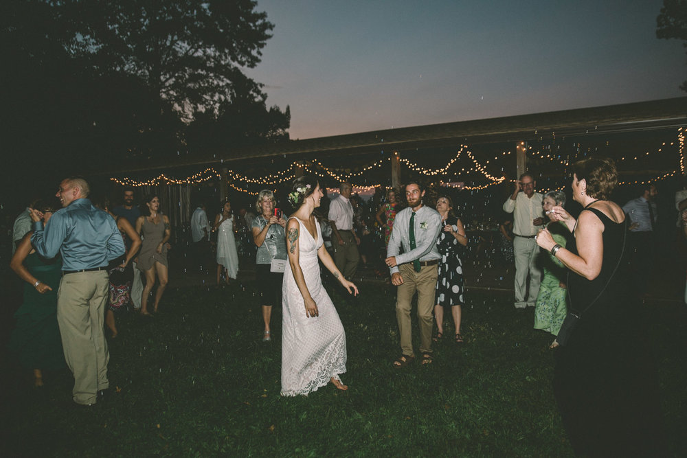 rustic barefoot dancing wedding steppingstone museum water bubbles.jpg
