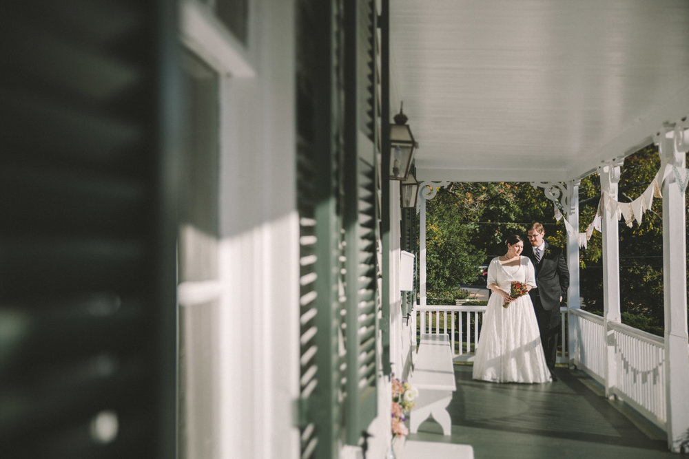cherry hill farmhouse wedding bride and groom porch.jpg