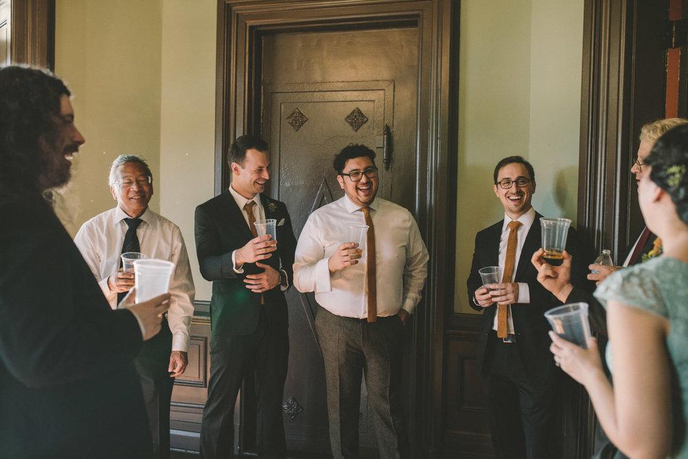 cylburn arboretum baltimore wedding groom hanging with groomsmen.jpg