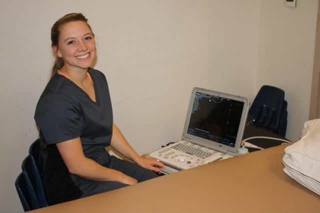 Jo White, a Stanton staff sonographer, prepares for the ultrasound machine's debut.