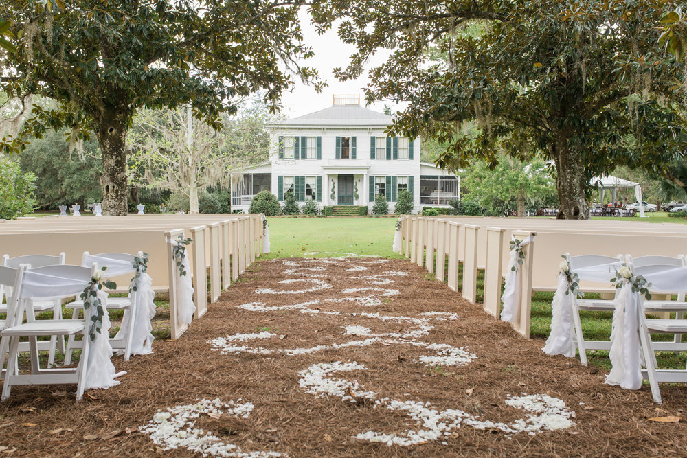 Ceremony outside of a beautiful historic mansion, The Linwood at Jacksonville wedding venue, The Glen