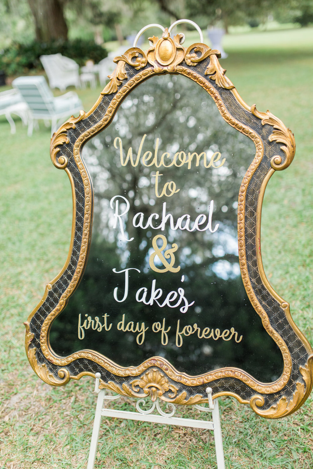 Custom signage for outdoor wedding ceremony