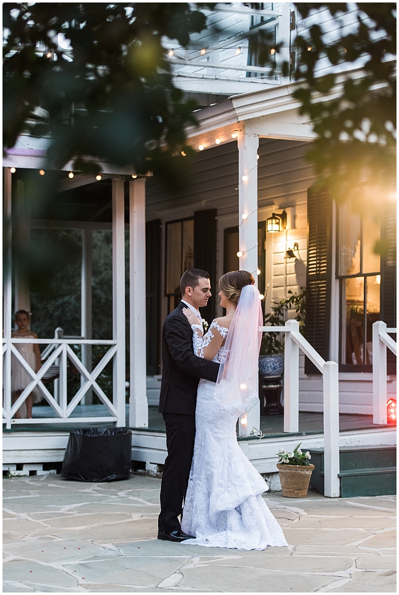 Bride and groom's first dance during outdoor wedding reception
