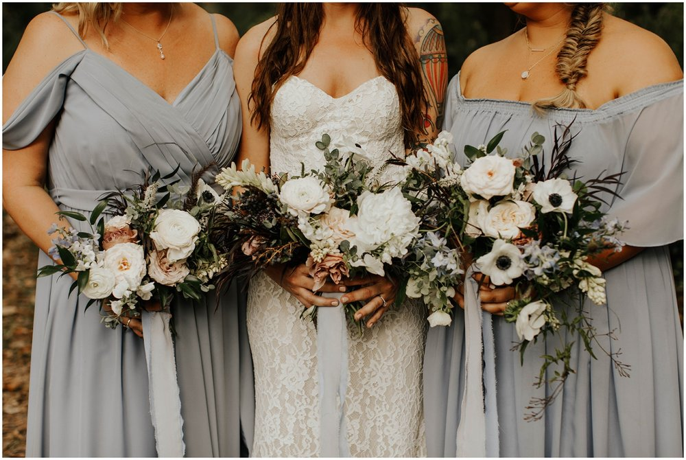 Bride and bridesmaids holding their wedding bouquets
