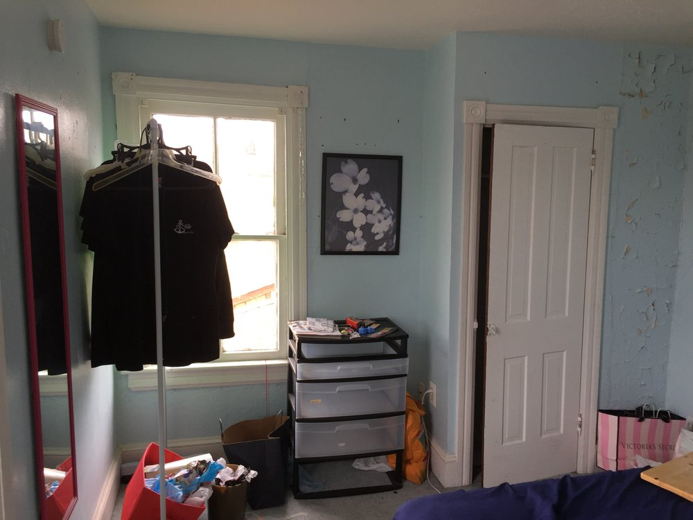 Bedroom is not totally trashed, but lots of peeling paint and clutter all around.