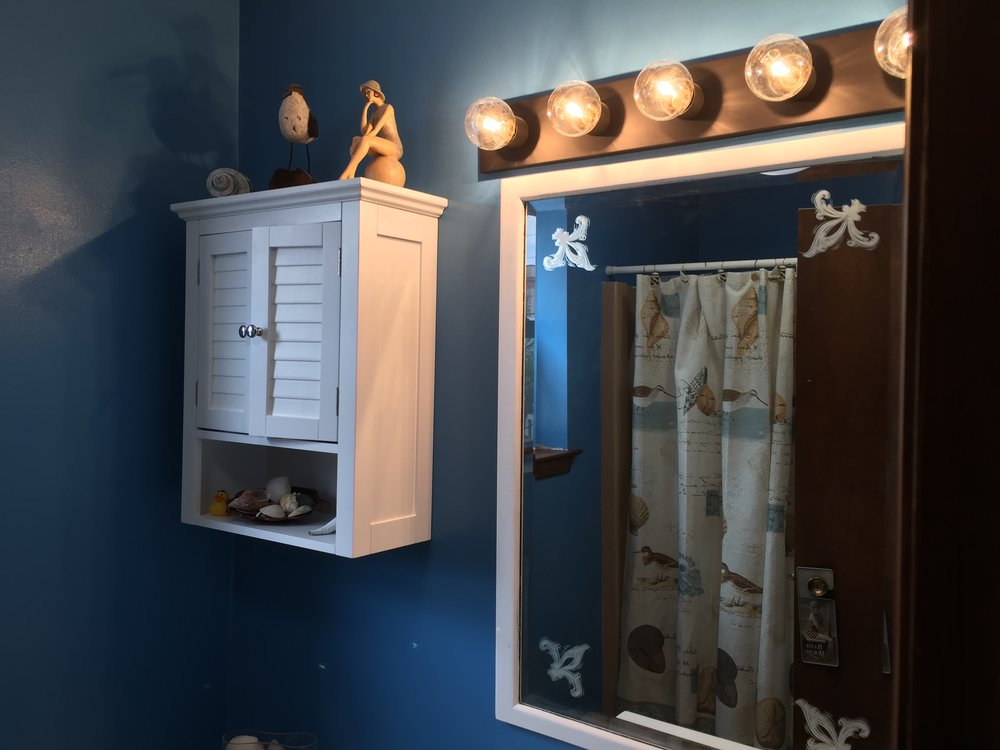 I repurposed the mirror but changed the orientation and applied chalk paint to match the cabinet.