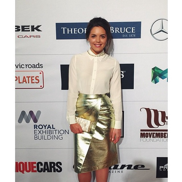 Mega babe @olympiavalance in our @msgm_official gold skirt, @equipment_fr shirt and @edie_parker clutch! Get yours online today with our #VOSN special! 25% off sitewide with he code VOSN25! Hurry, offer starts at noon and ends at midnight today. Olympia styled by @thecandicefiles. #vogue #shop #gracemelbourne (at www.gracemelbourne.com)