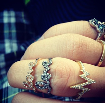 The Man Repeller Leandra Medine rocking not one, but two Sydney Evan LOVE rings - Lucky gal!